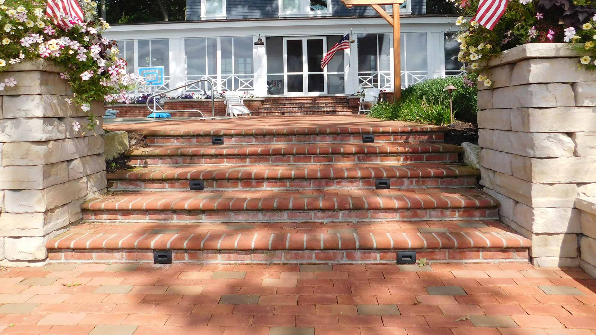 Custom brick stairs and retaining wall installed at a Hudsonville, MI home.