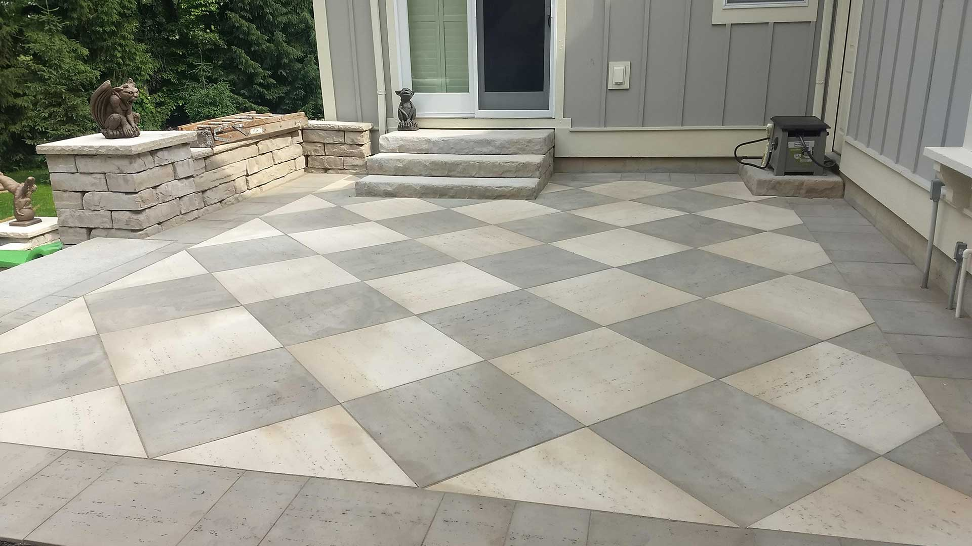 Checkered pattern patio construction in Grandville, MI.