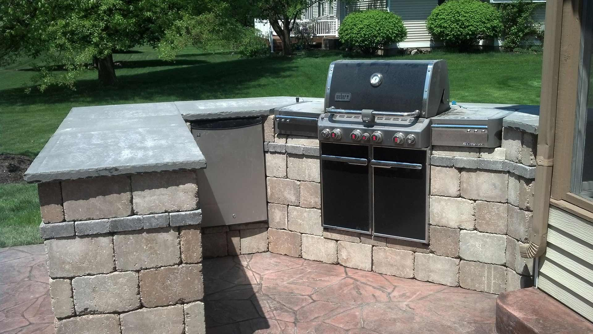 Custom outdoor kitchen living area constructed in Comstock Park, MI.