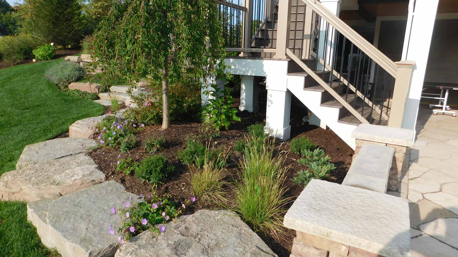 Corner mulch bed landscape feature in Cascade, MI.