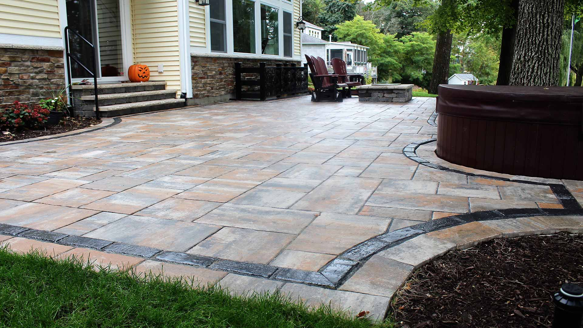 Custom home outdoor patio design in Ada, MI.