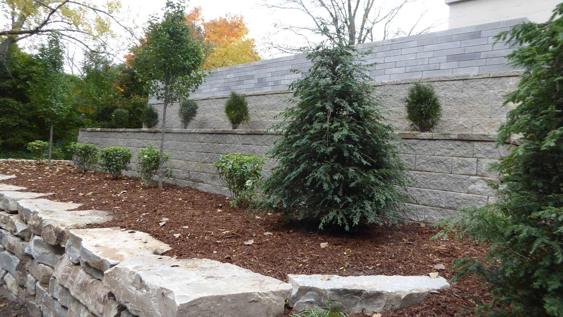 Tiered retaining wall with mulching planting fill.