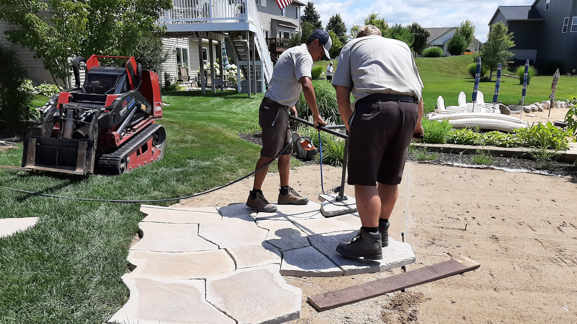 Our team of highly trained landscape professionals installing a new pathway.