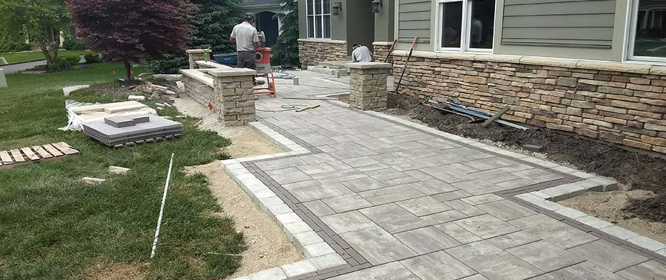 Choosing Flagstone or Concrete Pavers for Patio Construction