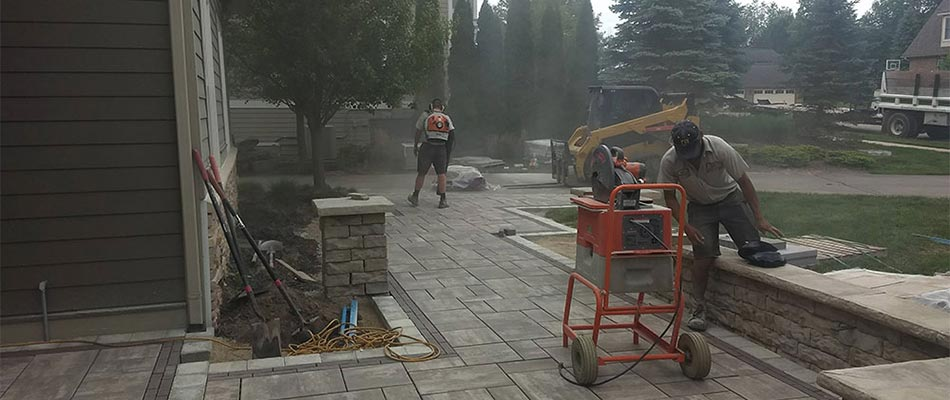 Custom paver patio and walkway being constructed at Grand Rapids, MI home.