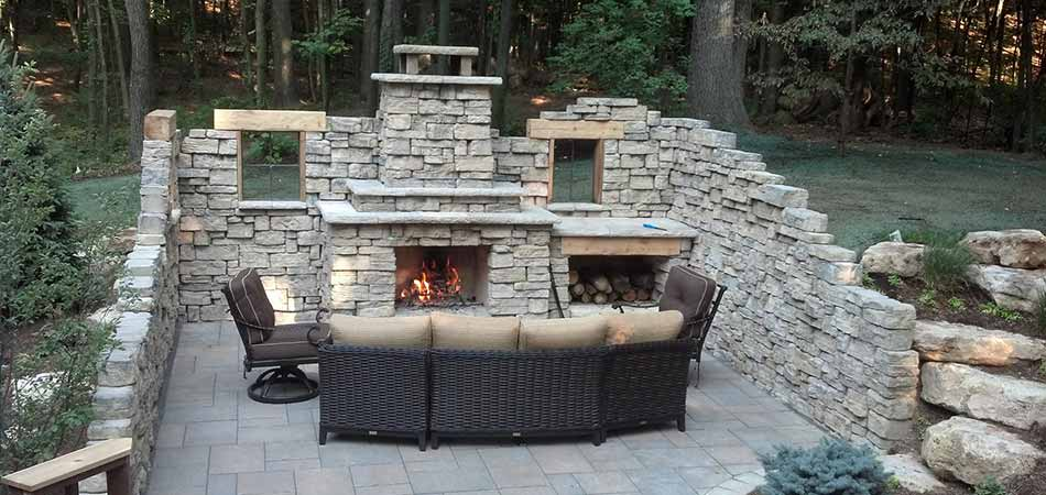 Custom stone fireplace and outdoor living area construction in Ada, MI.