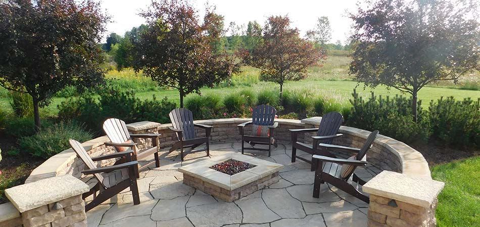 Custom stone fire pit and seating area in Grand Rapids, MI.