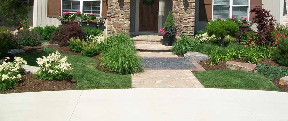 A Hudsonville, MI home with custom landscaping and plantings.