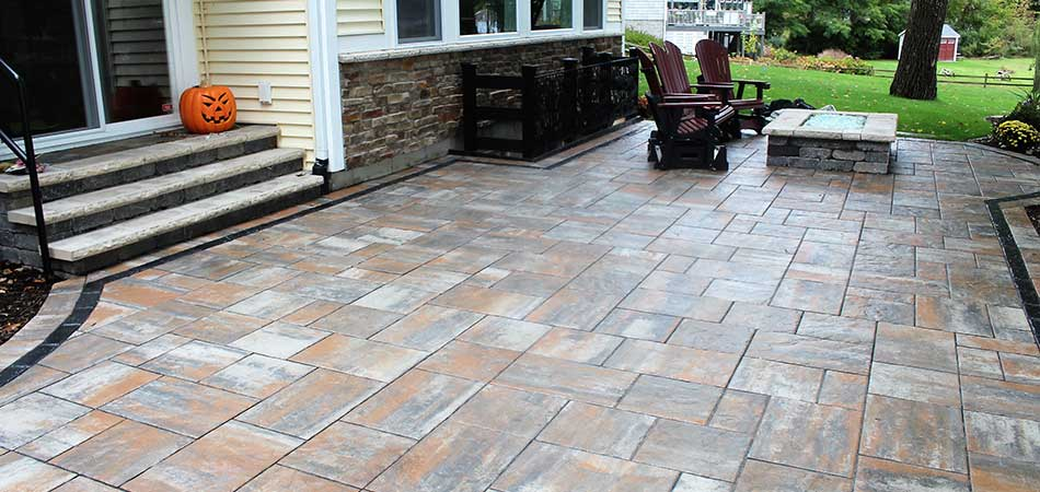 Custom stone patio design with pumpkin in Cascade, MI.