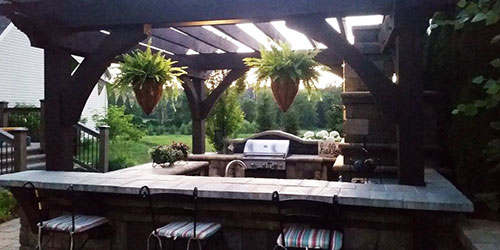 Outdoor kitchen and seating area in Ada, MI.
